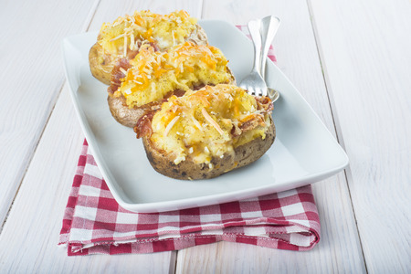 Twice baked potatoes stuffed with meat, jam, cheese and egg 写真素材