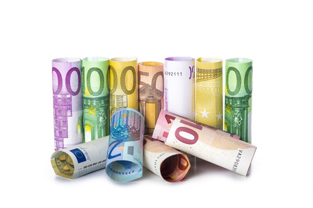 banknote: Rolled european banknotes isolated on a white background with a space for text