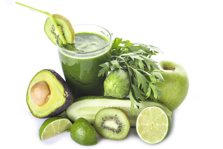 vegetables white background: Green smoothie with fruits and vegetables isolated on white background Stock Photo