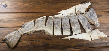 salted: Traditional cut of salted cod on a wooden board Stock Photo