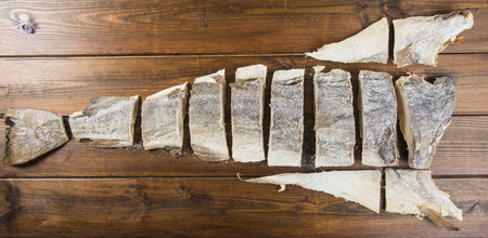 gastronomy: Traditional cut of salted cod on a wooden board Stock Photo