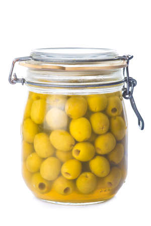 brine: Glass jar with pitted green olives in brine isolated on a white background