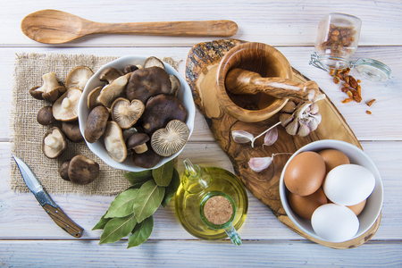 royale: King trumpet mushrooms and ingredients for cooking on the table of the kitchen Stock Photo