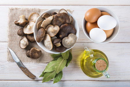 the fungus: King trumpet mushrooms and ingredients for cooking on the table of the kitchen Stock Photo