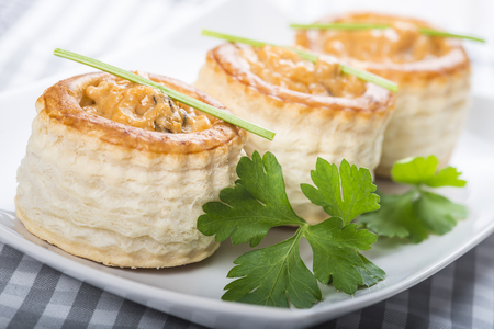 vent: vol au vent stuffed with seafood cream and decorated with a steam of parsley