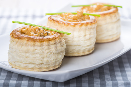 cream puff: vol au vent stuffed with seafood cream and decorated with a steam of parsley
