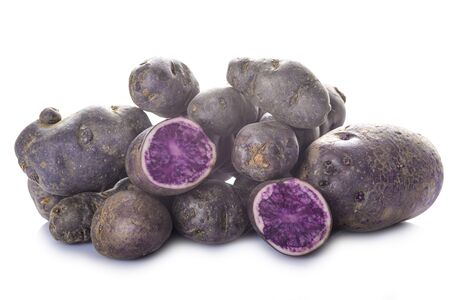 noire: Vitelotte or blue-violet potatoes isolated on a white background Stock Photo