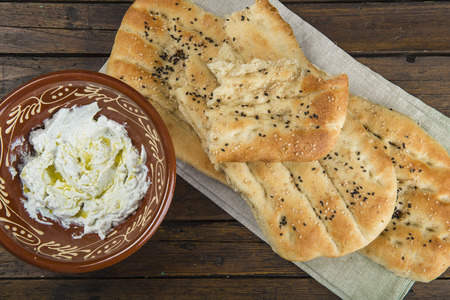 Barbari or Persian bread with strained yogurt, greek yogurt, yogurt cheese or labneh