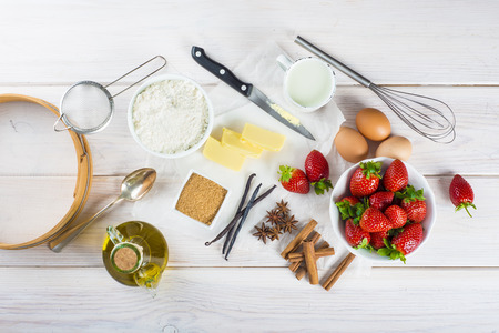 kitchen tool: Ingredients to cook an strawberry cake on the table of the kitchen Stock Photo