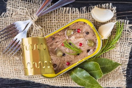 heathy: Light tuna in olive oil canned dressed with herbs and spices on a burlap and a wooden background Stock Photo