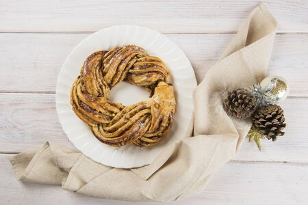 kringle: Kringle or pretzel, traditional Christmas dessert in Northen Europe with cinnamon and walnuts