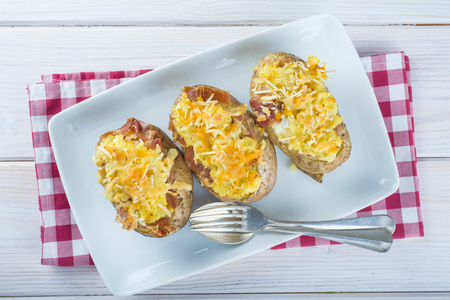 baked meat: Twice baked potatoes stuffed with meat, jam, cheese and egg Stock Photo