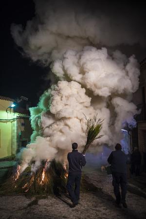 worse: Men preparing bonefires with worse to celebrate saint Anthonys day Stock Photo