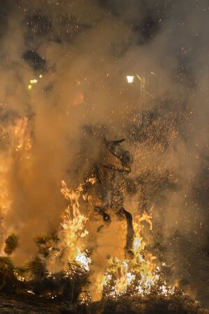 bartolome: Men rides his horses through the fire in the traditional celebration of Saint Anthonys day in the small village of San Bartolome de Pinares in Spain Stock Photo