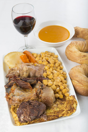 Spanish cocido is a stew with assortment of meat from different animals and chikpeas