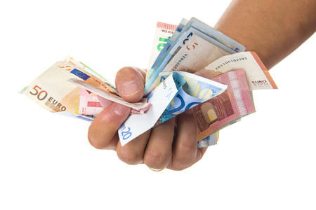 Hand holding a lot of money isolated on a white background Stock Photo