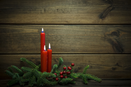 happines: Christmas background made of wood with candles Stock Photo