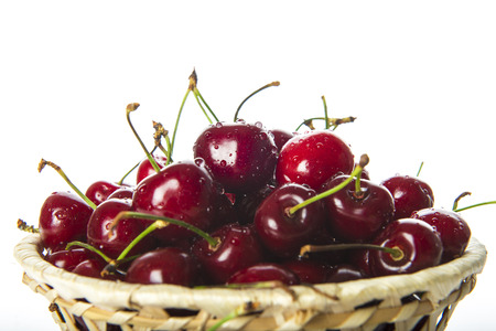 cherries isolated: Basket with fresh cherries isolated on a white background
