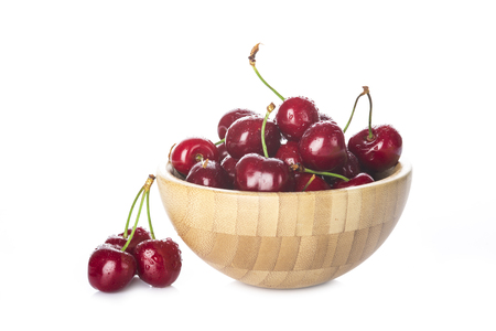 cherries isolated: Wooden bowl with fresh cherries isolated on a white background