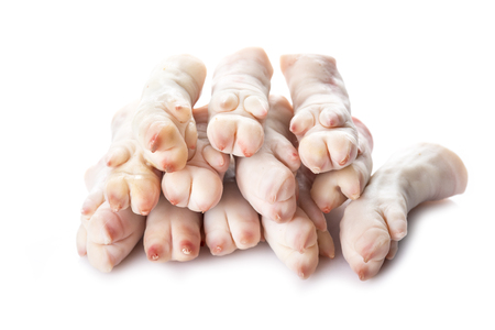 Raw crubeens or pig trotters isolated on a white background Stock fotó