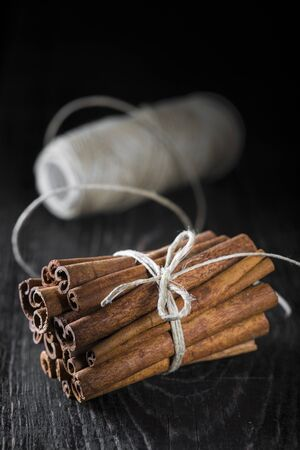 Cinnamon sticks bunch on a dark background