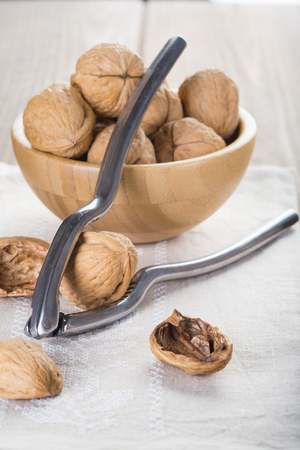Cracking and shelling walnuts with a nutcracker