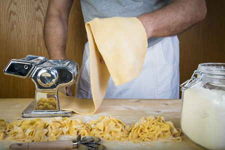Making fresh egg pasta at home with natural ingredients and a basic machine