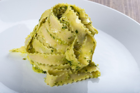 Homemade fresh egg pasta with pesto sauce for lunch
