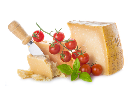 Parmesan cheese or parmigiano reggiano with cherry tomatoes and basil leaves isolated on a white background 写真素材