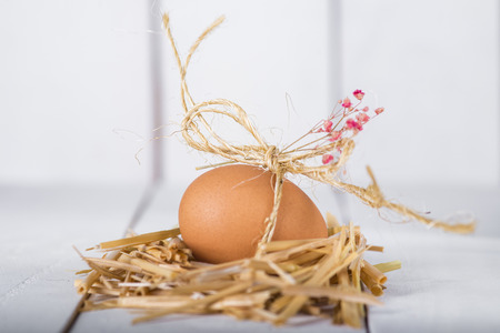 Easter egg decorated on a white wooden background 写真素材
