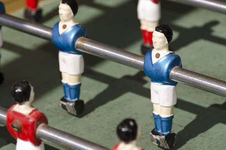 blue football player in toy Stock Photo