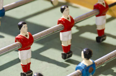 Red football player in toy