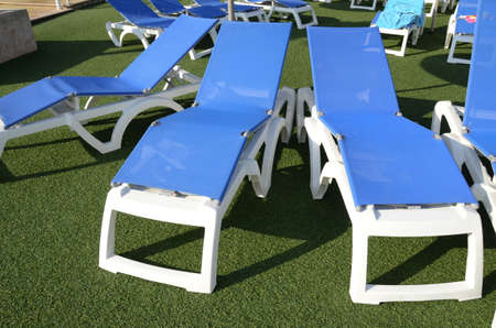 chairs at poolside