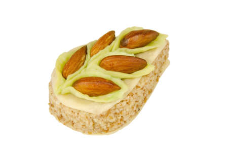 pastry ornamented with almonds isolated Stock Photo