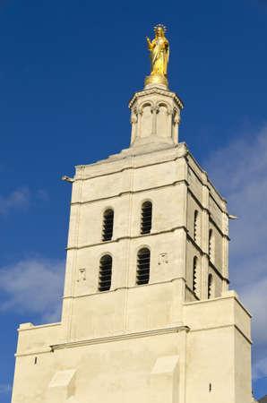 golden virgin statue, symbol of catholicism