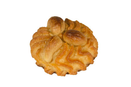 pastry decorated with cashew nuts isolated