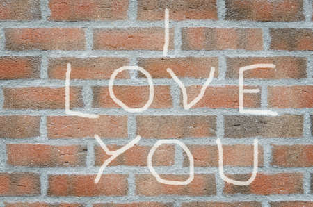 i love you inscription painted on a brick wall Stock Photo
