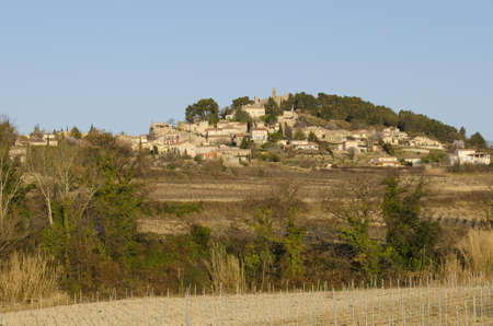 old village perched on a hill, Rasteau in Provence, France Stock Photo