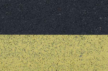 yellow marking on asphalt, textured background Stock Photo - 12871525