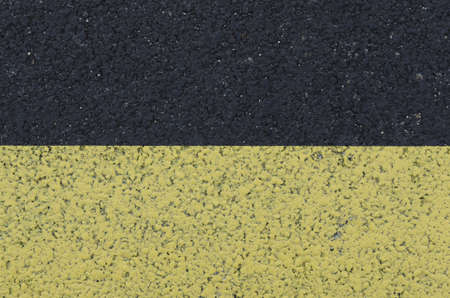 yellow marking on asphalt, textured background Stock Photo - 12871525