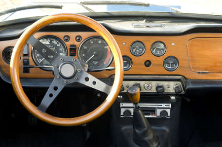 wooden dashboard of a vintage car Stock Photo