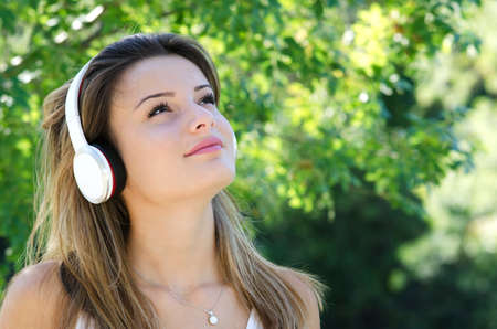 portrait of a young girl listening to music with headphones Stock Photo