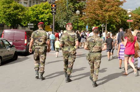 Paris, France-August 13, 2013: soldiers patrol in Paris against the risk of terrorist attack Editorial