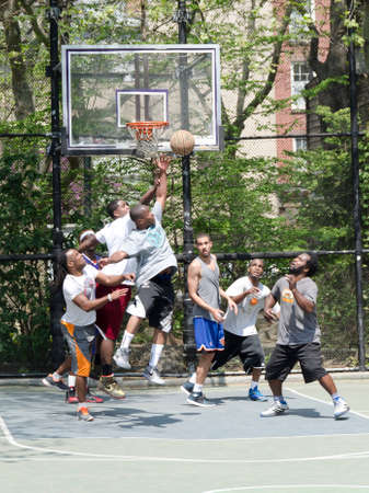 New-York City, USA-May 04, 2015: young men in action playing basketball in the street Editorial