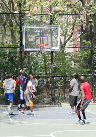 New-York City, USA - May 04, 2015: young men in action playing basket ball in the street