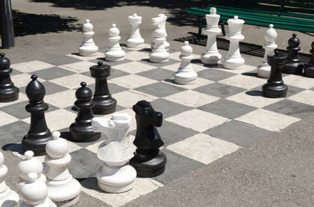 giant chess game on the asphalt Stock Photo