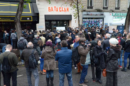 Paris, France November 13, 2016: Crowd in front of the Bataclan paying tribute to the victims of the terrorist attacks one year ago