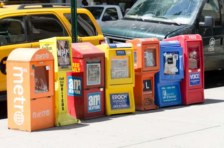 New-York City, USA - May 4, 2015: free newspaper dispensers in a street of Manhattan