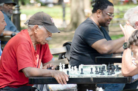 New York City, USA - May 4, 2015: old man playing chess in Washington square Park in Manhattan
