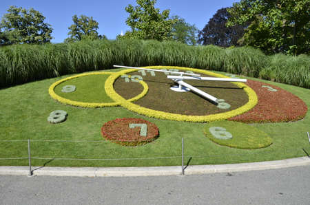 Clock made with several flowers and grass in Geneva, Switzerland